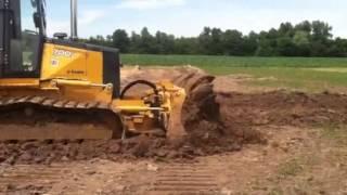 Bull Dozer John Deer 700 pushing dirt
