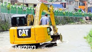 Mini Excavator CAT 307E Working On The River