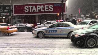 New York City Police Department pulling over a Taxi in a Snowstorm