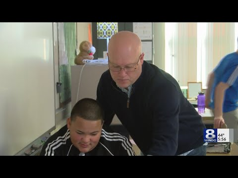Golden Apple: East Irondequoit Middle School teacher awarded for student-first style