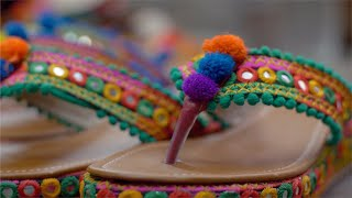 Pan shot of Rajasthani footwear for women