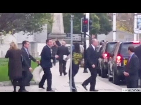 Security alert: man runs at British PM, David Cameron