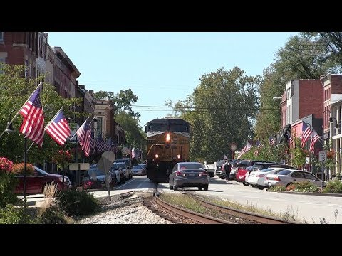 CSX Train Chases car on Street Running!