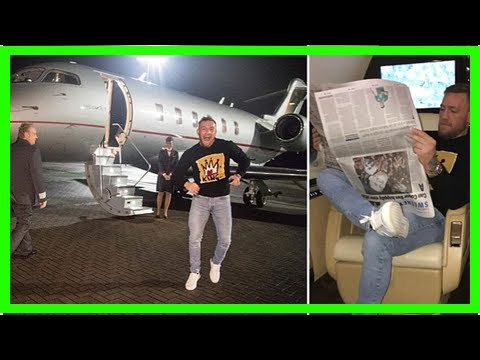 Conor mcgregor reads the newspaper upside down as ufc lightweight champion jets out of ireland on a