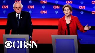 warren-and-sanders-defend-liberal-vision-on-first-night-of-detroit-debates