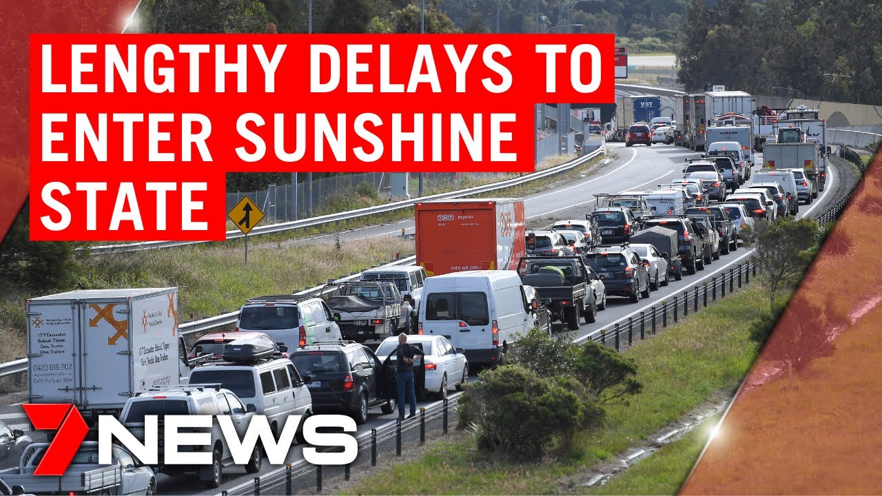 Lengthy delays as holidaymakers are finally allowed into Queensland | 7NEWS