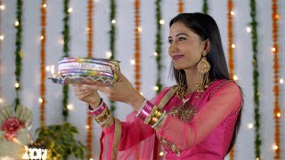 Young attractive woman performing Karwa Chauth rituals in traditional wear - festival season