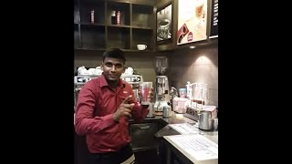 Sanjay Demonstrating How to Make Iced Latte at Costa Coffee