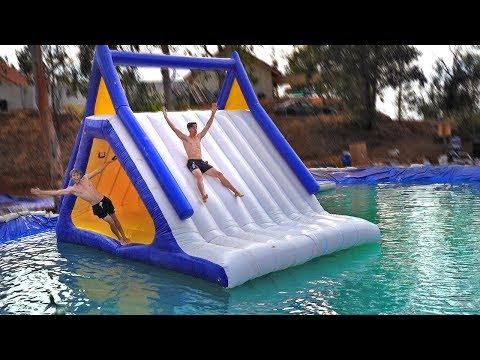 BACKYARD floating WATERPARK inside of POND! *Mega Slip N Slide*