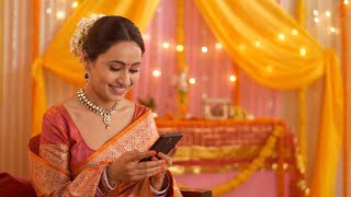 Happy Indian woman thinking and texting a friend or husband - Festival decoration and puja scene