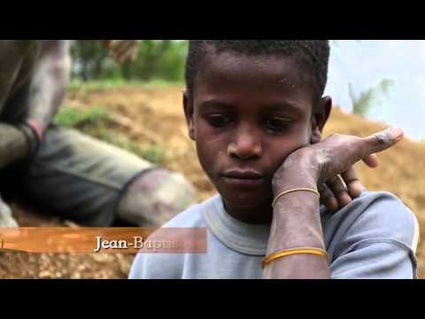 Mud Cookies - Children Of Haiti Eating