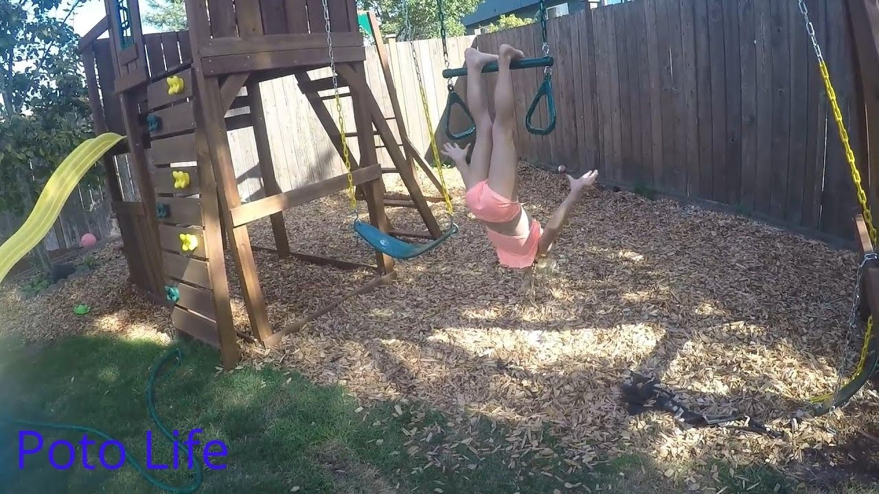 gymnastics in the backyard and a new play set with 5 year old brea