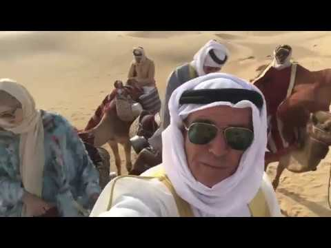41b75add Pierce Brosnan shooting The Misfits In Dubai: Camel Ride with Chuck ...