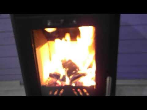 печь-камин Брандербург. Отопление дома из бруса . Дверка со стеклом