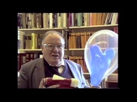 Arthur Schawlow pops a balloon