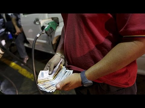 As oil prices slide, Venezuela raised fuel prices by up to 6,000%, devalues currency