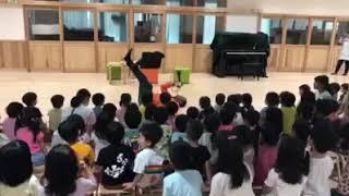 #tripwithskip trumpet solo with kindergarten kids in Okinawa 052918