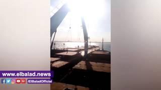 ميناء الإسكندرية ينجح في تعويم سفينة جانحة بالدخيلة.. صور وفيديو
