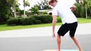 Street Surfing With Caelen Burford On The Huntington Hop