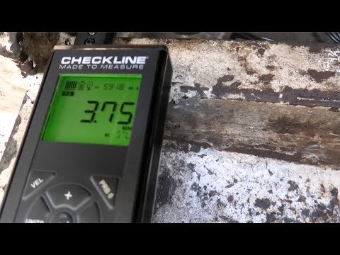 Ultrasonic thickness testing the steel hull plates on the trawler