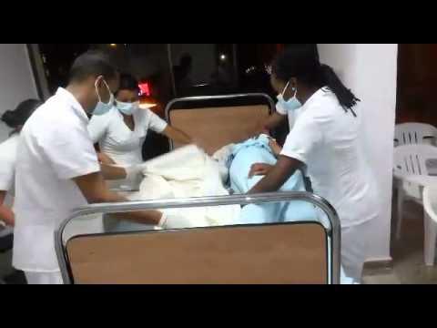 Tendidos de cama con paciente youtube for Cama ocupada