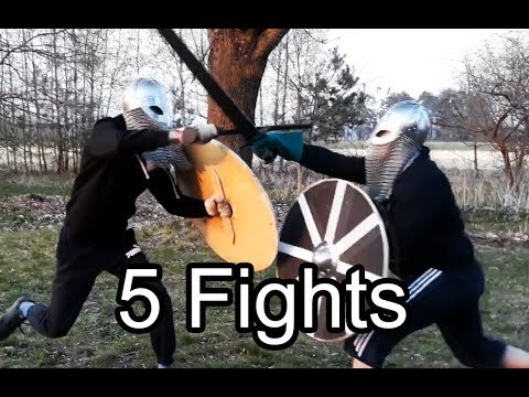Viking round shield and wooden sword practice fighting