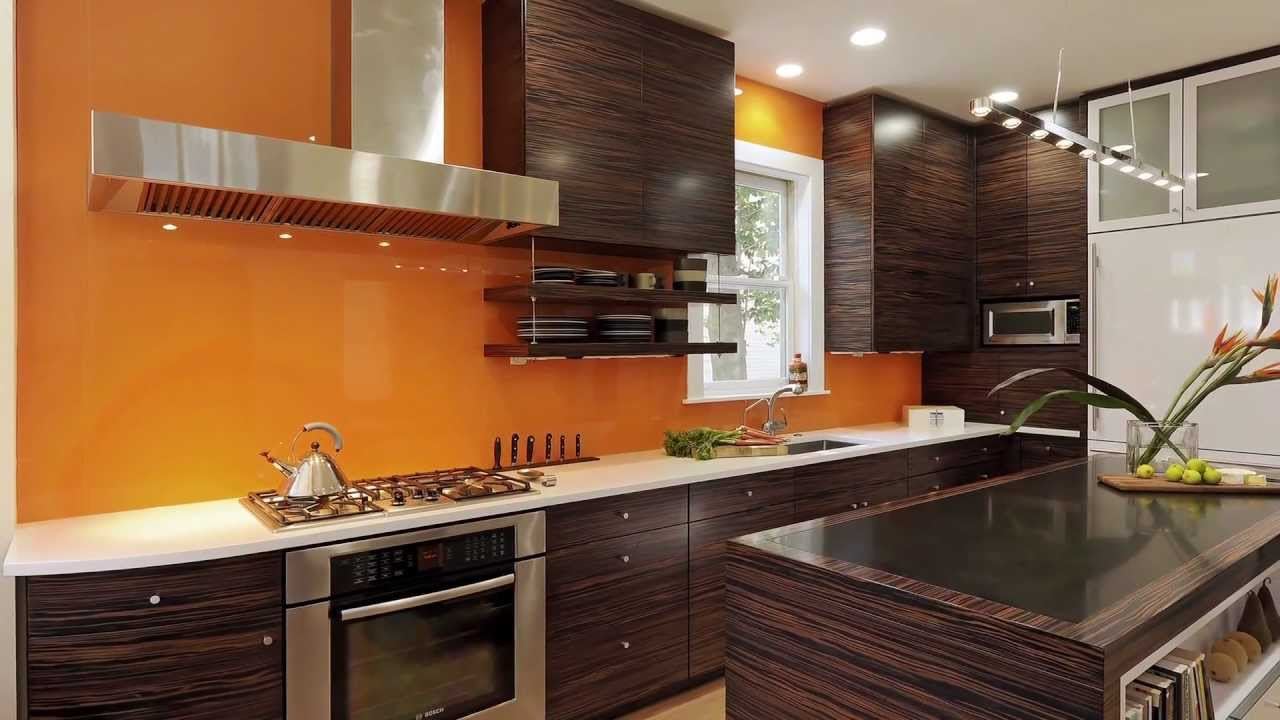 Kitchen Remodel Featuring Calypso Orange Back Splash Feature Wall And Dark Wood Finished Cabinetry You