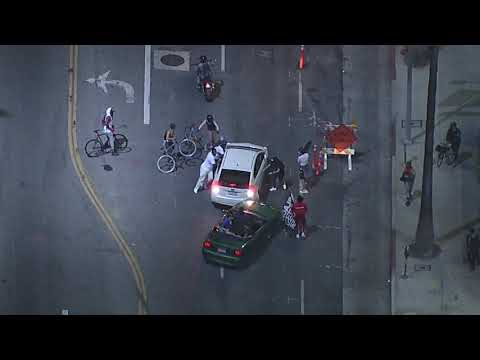 Driver attacked after driving through protest crowd in Hollywood | ABC7 Los Angeles