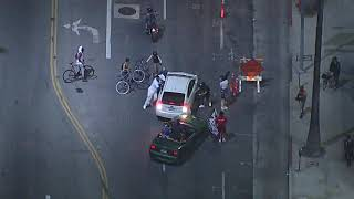 Driver attacked after driving through protest crowd in Hollywood   ABC7 Los Angeles