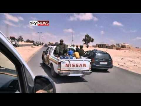 LIBYA REBELS FLEE FROM GADDAFI FORCES ONSLAUGHT