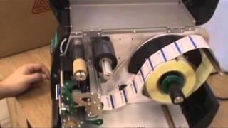 Инструкция по установке расходных материалов на термотрансферный принтер AP 5.4(Демонстрация установки ролика с этикетками-заготовками и термотрансферной ленты (риббона, красящей ленты)...., 2013-03-19T08:32:59.000Z)