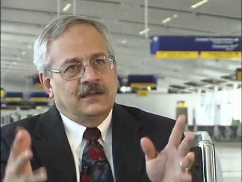 Mayor Greg Ballard and John Kish discuss Col. H. Weir Cook Terminal