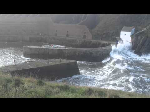 Porthgain harbour (Pembrokeshire, Wales) in stormy sea