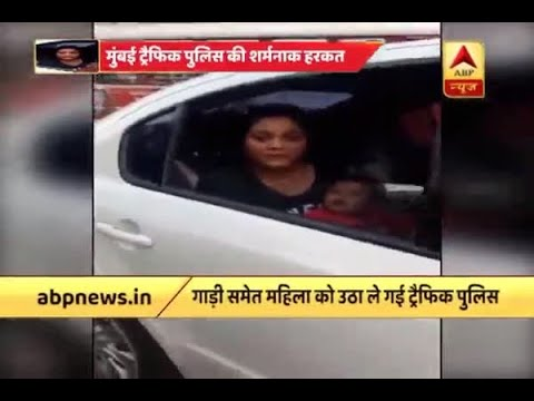 Mumbai Police tow car with woman breastfeeding her baby