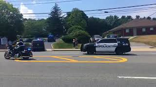Community, police line streets for Weymouth Police Officer Michael Chesna's procession