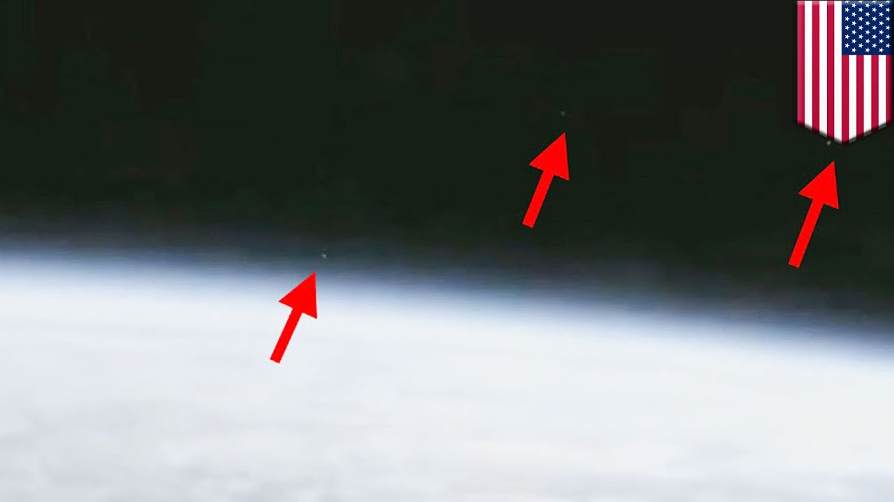 VIDEO NASA cuts live video transmission as THREE UFOs fly