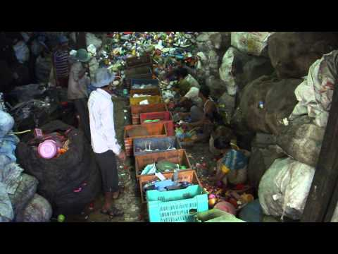 Slum Workers Sorting Plastic