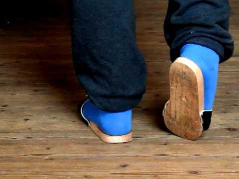 Exercise sandals on a wooden floor