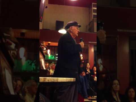 Roberto Traina singing at Cafe Mediterraneum