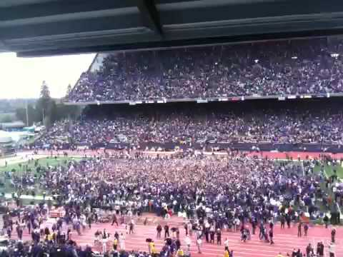 Huskie Fans rush the field after USC win!