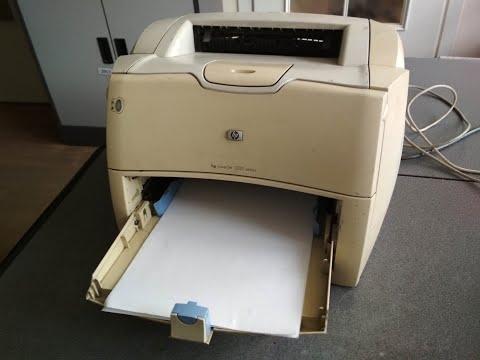 Принтер HP 1200 захватывает по несколько листов