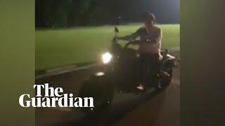 Philippines president Rodrigo Duterte rides his motorbike before crashing