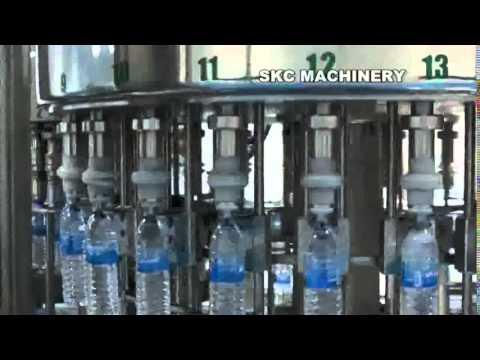 SKC MACHINERY :เครื่องบรรจุน้ำดื่มแบบซุปเปอร์บล็อค เครื่องแพคฟิล์มหด (อัตโนมัติ)