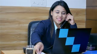 Busy indian female manager speaks over the phone with a client