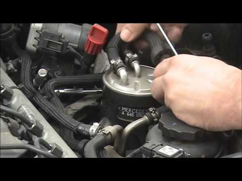 Fitting and bleeding a Mercedes diesel fuel filter - YouTube