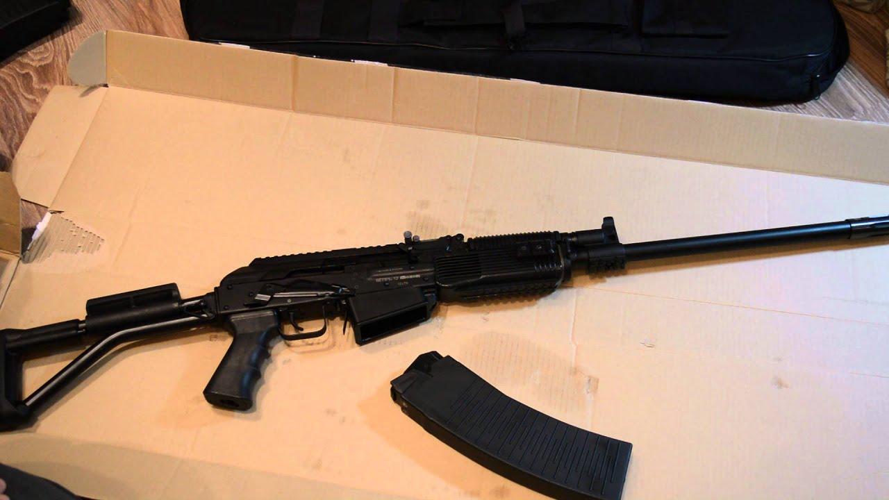 Стрельба из Vepr 12 Вепрь 12 Молот ВПО 205 12 калибра по колесу .