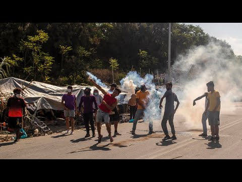 Teargas fired at migrant protesters on Greek island of Lesbos