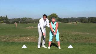 IMPROVE YOUR RANGE OF MOVEMENT, PARTICULARLY A RESTRICTED BACKSWING TURN, USING THE SURE-SET