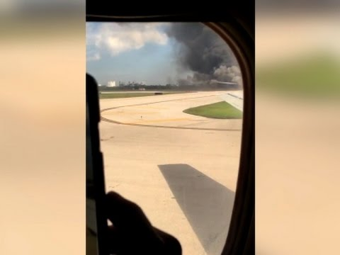 Plane catches fire at Fla. airport; 15 hurt, 1 burned