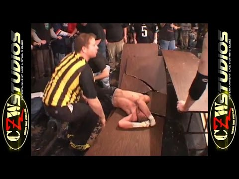 CZW Cage of Death 6: Chri$ Ca$h takes BLK Jeez from the top of the cage! (CZWstudios.com)
